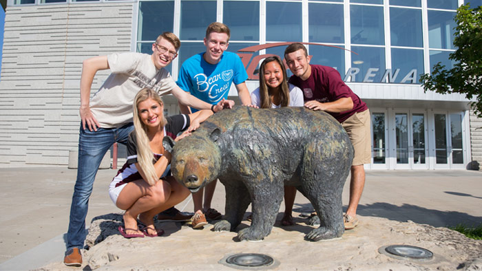 students around the Bear at JQH Arena